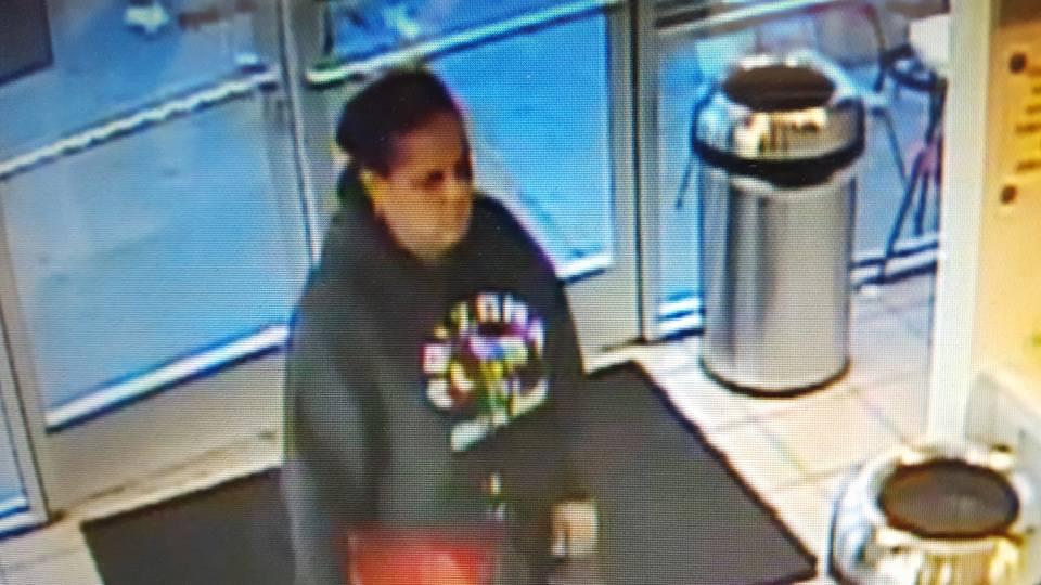 Woman steals from local yogurt shop.