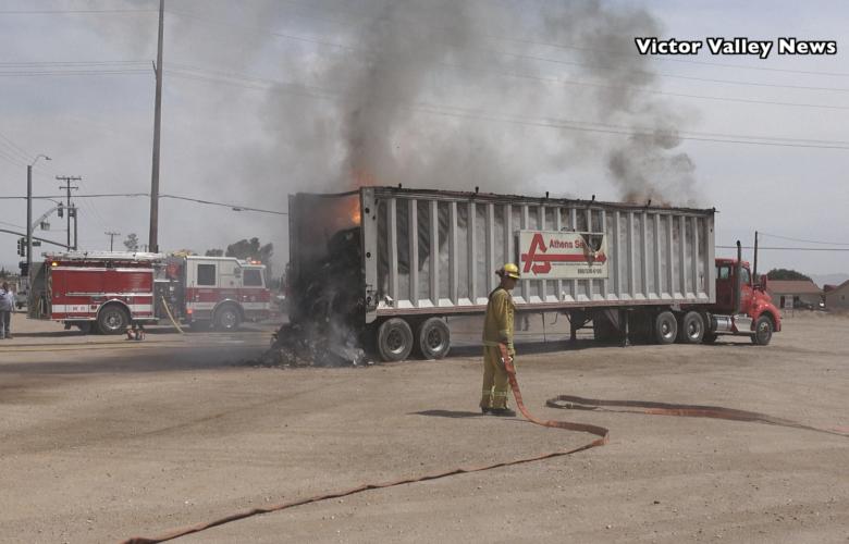 Dump truck catches fire on Phelan Road Saturday morning. (Gabriel D. Espinoza)