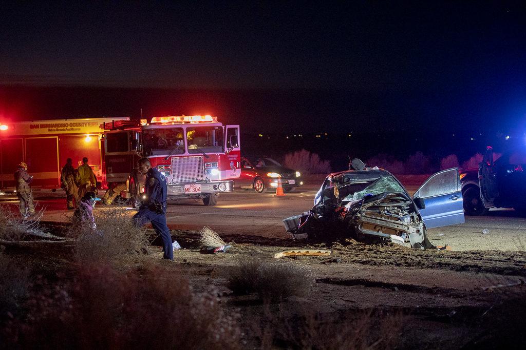 A California Highway Patrol Officer interviews the driver of the sedan. (Hugo C. Valdez, Victor Valley News)