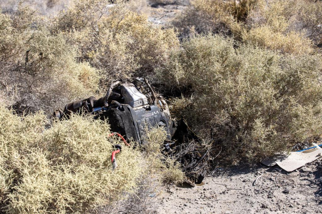 The motor of the Camaro landed several feet away in shrubs. (Hugo C. Valdez, Victor Valley News)