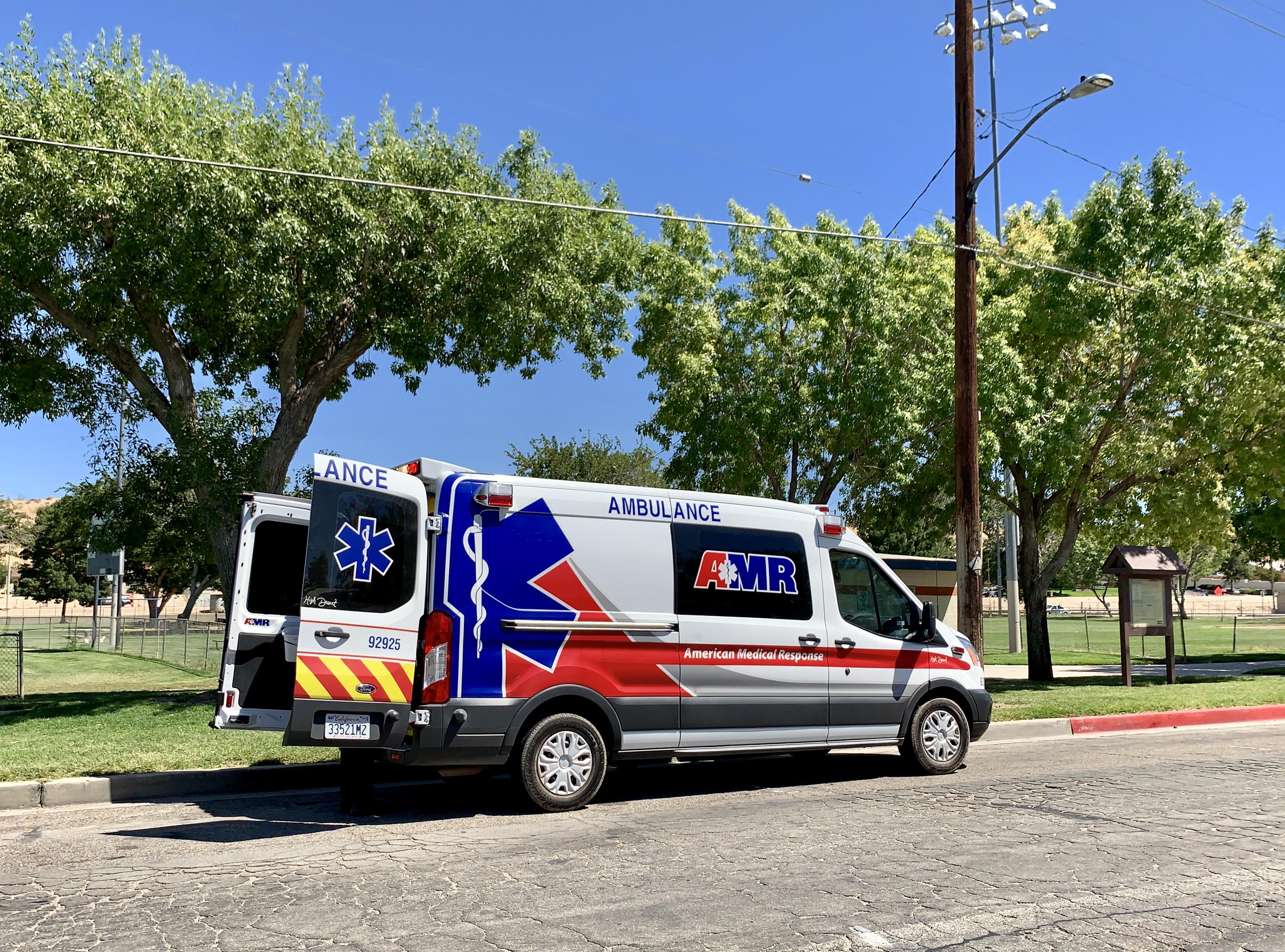 AMR paramedics preparing to transport the dog bite victim. (Hugo C. Valdez, Victor Valley News)