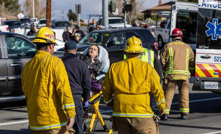 The suspect was placed on a gurney and into an AMR ambulance. (Hugo C. Valdez, VVNG.com)