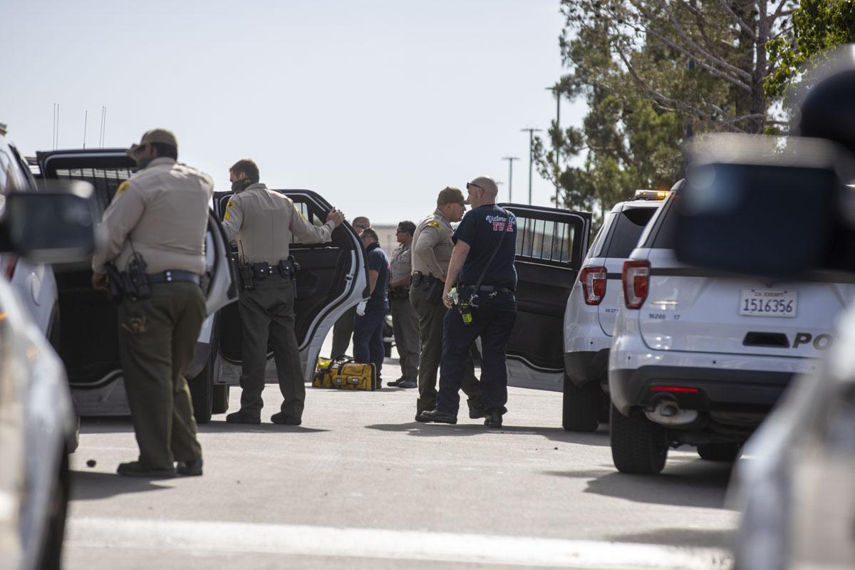 Three adults and one juvenile were arrested for robbery. (Hugo C. Valdez, VVNG.com)